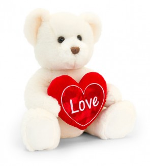 Hvid bamse med rødt hjerte med teksten 'love'